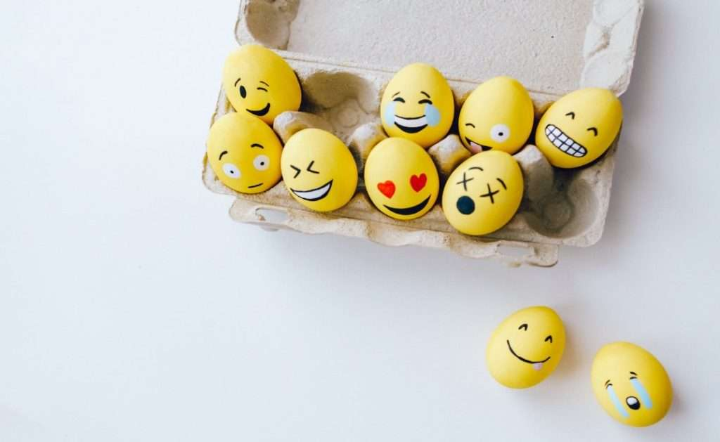 Eggs painted as emoji faces