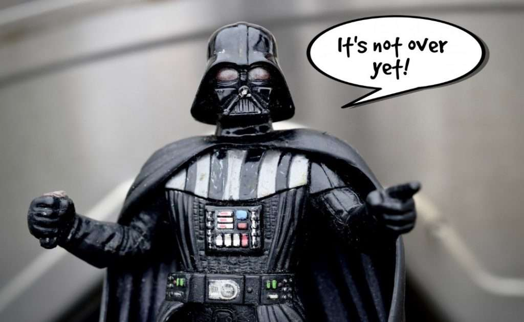 Darth Vader figure says 'it's not over yet' with speech bubble