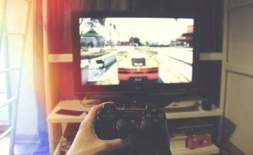Video Game controller in front of TV